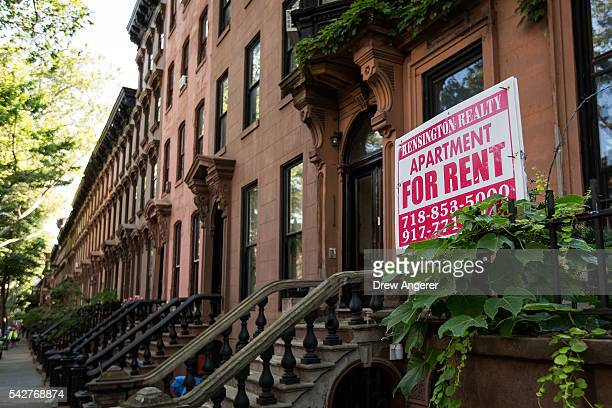 Sign advertises an apartment for rent along a row of brownstone townhouses in the Fort Greene neighborhood on June 24, 2016 in the Brooklyn borough...