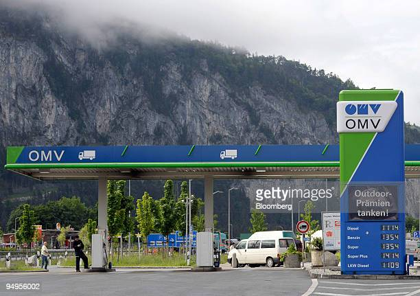 A sign advertises fuel prices at an OMV gas station in Kiefersfelden Germany on Monday May 18 2009 Demand for distillate fuel which includes diesel...