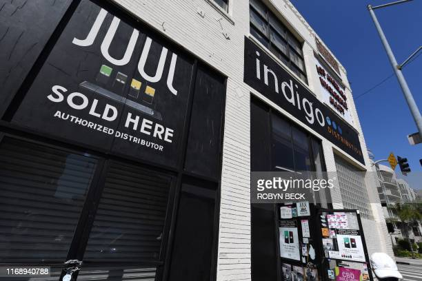 Sign advertises Juul vaping products in Los Angeles, California, September 17, 2019. - New York became the second US state to ban flavored...
