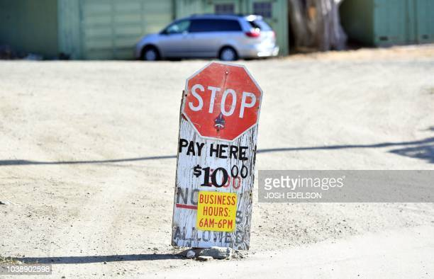 A sign advertises parking rates near Martin's Beach in Half Moon Bay California on September 19 2018 Billionaire Vinod Khosla purchased the land and...