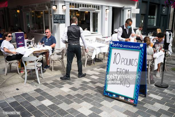 A sign advertises the Eat Out to Help Out discount at a restaurant on August 05 2020 in London United Kingdom Throughout August the British...