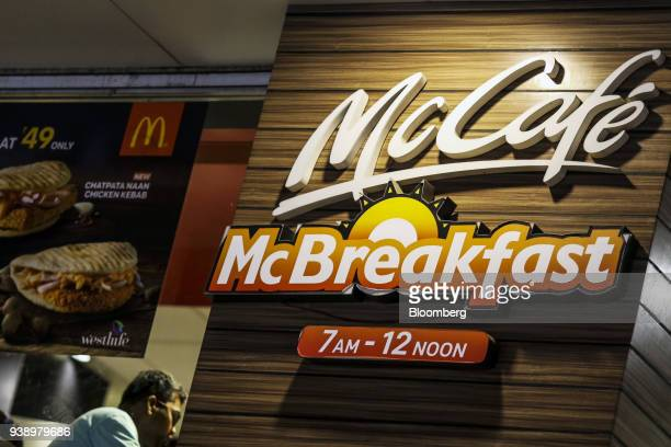 A sign advertises the McCafe McBreakfast at a McDonald's Corp restaurant operated by Hardcastle Restaurants Pvt in Mumbai India on Tuesday March 20...