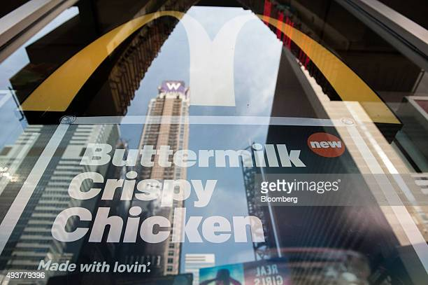 A sign advertises the new buttermilk crispy chicken sandwich at a McDonald's Corp restaurant in New York US on Thursday Oct 22 2015 McDonalds Corp...