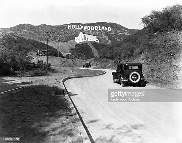 Sign advertises the opening of the Hollywoodland housing development in the hills on Mulholland Drive overlooking Los Angeles, Hollywood, Los...