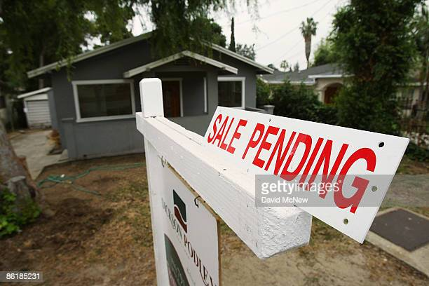 Sign advertises the pending sale of a house on April 23, 2009 in Pasadena, California. About half of all homes sold last month were sold to...