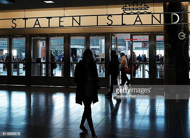 Sign advertises the Staten Island Ferry on October 14, 2016 in New York City. Staten Island, a New York City borough, is in the grip of a heroin...