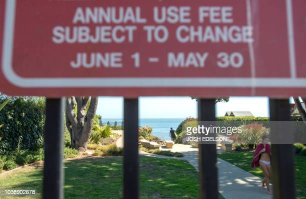 A sign advertises use fees to access Privates Beach in the Opal Cliffs area of Santa Cruz California on September 19 2018 Local officials charge a...