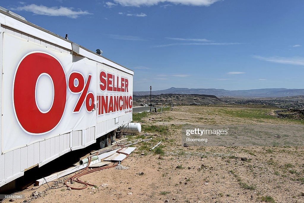 A sign advertises zero percent seller financing next to an undeveloped new home lot for sale in St. George, Utah, U.S., on Wednesday, May 26, 2010. Housing starts rose to a 672,000 annual rate last month, the highest since October 2008 and up 5.8 percent from March, Commerce Department figures showed this month. After almost five years of falling sales and prices, homebuilders are looking to see if the nation's fledgling economic recovery can sustain the real estate market as government subsidies end. Photographer: George Frey/Bloomberg via Getty Images