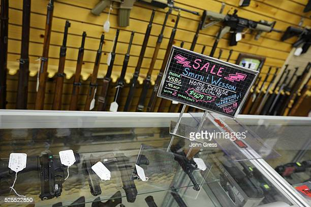 """Sign advertising a """"Home Defense Special"""" at the Shooters Shop in West Allis, Wisconsin, on August 7 the same store where alleged gunman Wade Michael..."""