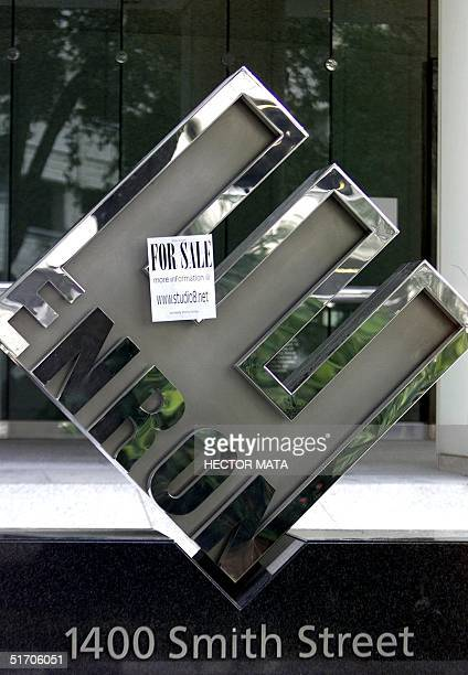 A sign advertising a humorous website is pasted on the ENRON sign at the entrance of their headquarters in Houston Texas 26 January 2002 The energy...