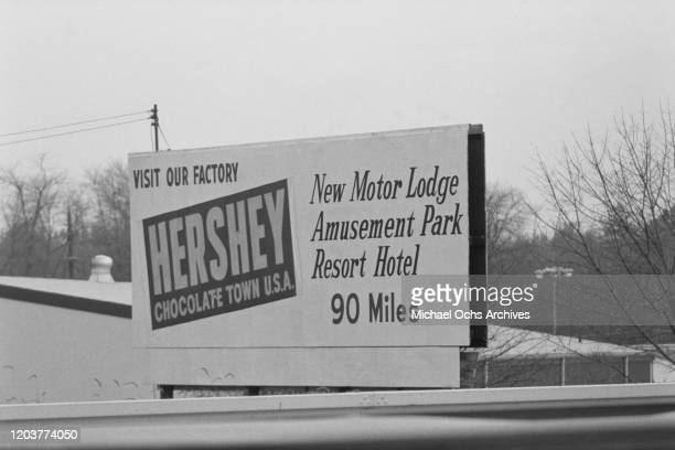 A sign advertising a visit to the chocolate factory 90 miles away in Hershey Derry Township Pennsylvania USA November 1969 The town boasts a new...