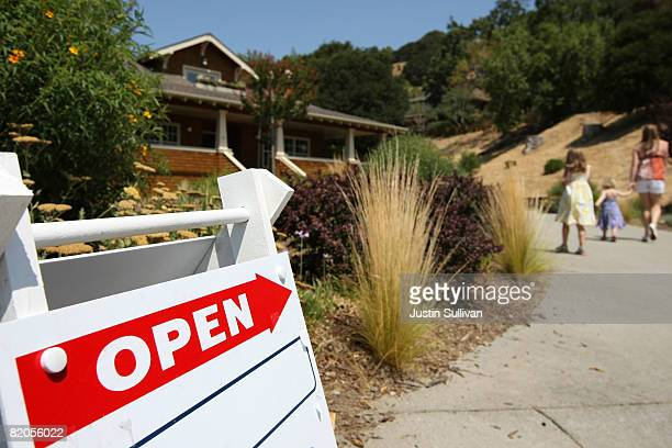 A sign advertising an open house is posted outside a home for sale July 24 2008 in Fairfax California According to a report by The National...