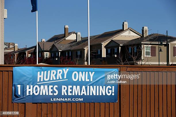 A sign advertising available homes is posted at a housing development on December 4 2013 in Dublin California According to a Commerce Department...