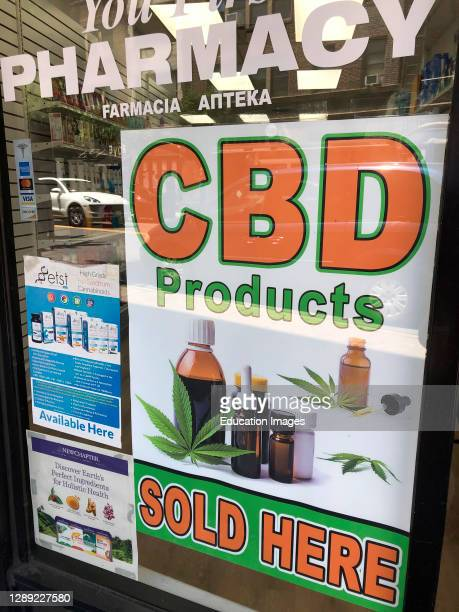 Sign advertising CBD products sold here, Queens, NY.