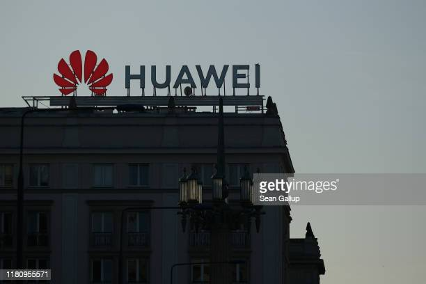 A sign advertising Chinese telecoms equipment manufacturer Huawei stands on an apartment building on October 11 2019 in Warsaw Poland Some countries...