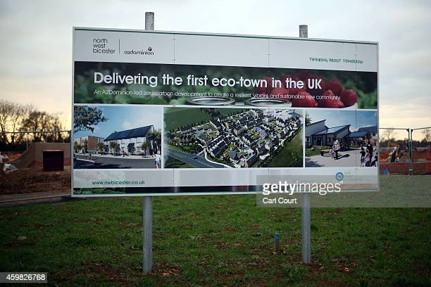 A sign advertising construction of the first ecotown in the United Kingdom is pictured on December 2 2014 in Bicester England Up to 13000 new homes...