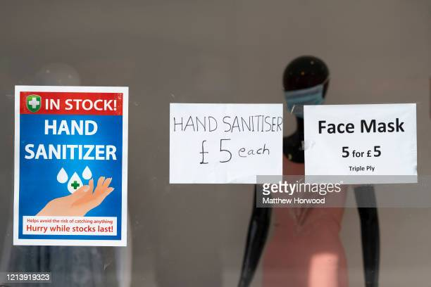 A sign advertising hand sanitiser and surgical face masks for sale in a shop in central Cardiff on March 21 2020 in Cardiff United Kingdom...