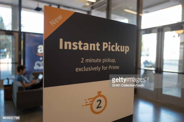 Sign advertising 'Instant Pickup' in 2 minutes or less from the Amazon Prime service of Amazoncom at UC Berkeley in Berkeley California October 6 2017