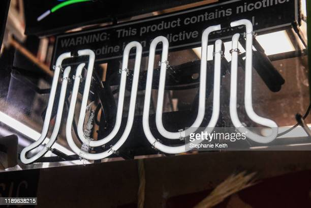 Sign advertising JUUL products is displayed in a store on December 19, 2019 in New York City. Congress raised the legal age to smoke or vape to 21....