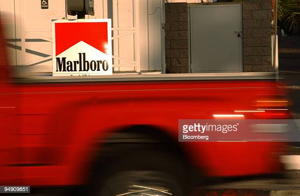 A sign advertising Marlboro brand cigarettes hangs from a post at a San Diego California service station on Sunday morning January 25 2004