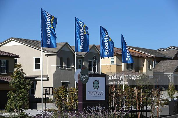 A sign advertising new homes is posted at a housing development on December 4 2013 in Dublin California According to a Commerce Department report...