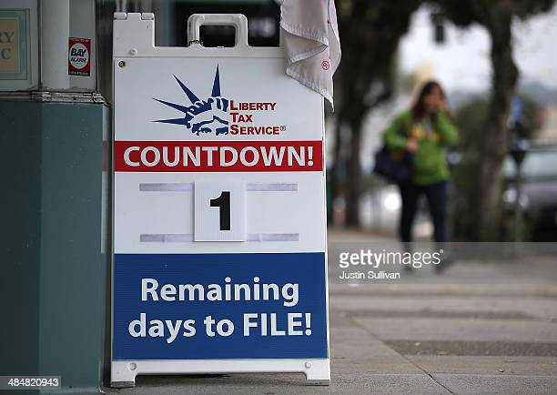 A sign advertising one day remaining before the tax filing deadline is posted in front of Liberty Tax Service on April 14 2014 in San Francisco...