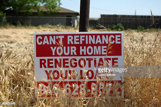 A sign advertising refinancing services is posted in a vacant lot April 29 2008 in Stockton California As the nation continues to see widespread home...