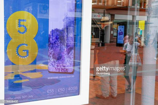 A sign advertising the 5G network sits on display inside the window of an EE mobile phone store operated by BT Group Plc in Reading UK on Monday July...