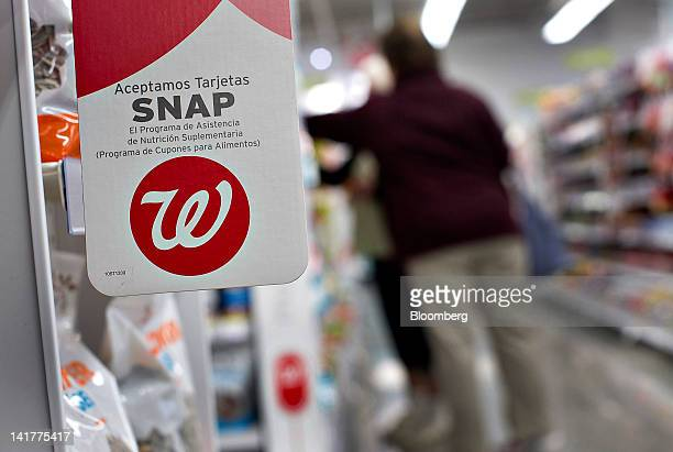 A sign advertising the acceptance of Supplemental Nutritional Assistance Program cards is displayed at a Walgreen Co store in Chicago Illinois US on...