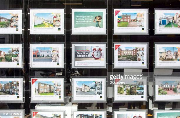 Sign advertising the end of the stamp duty holiday in the window of an estate agents in Colchester, U.K., on Friday, Feb. 26, 2021. The housing boom...