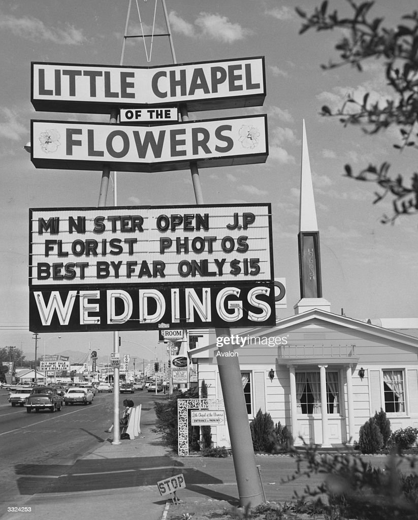A sign advertising the little chapel of the flowers in las vegas drive in weddings news photo mightylinksfo