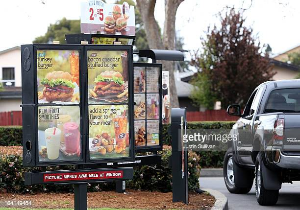 A sign advertising the new Burger King turkey burger is displayed at the drive thru of a Burger King restaurant on March 20 2013 in Oakland...