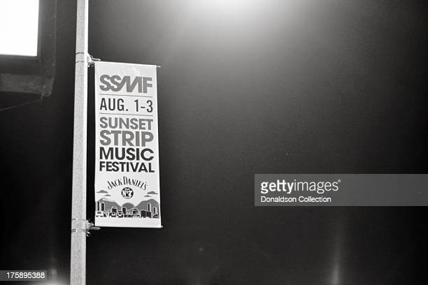 A sign advertising the Sunset Strip Music Festival hangs outside the Viper Room night club on August 2 2013 in Los Angeles California