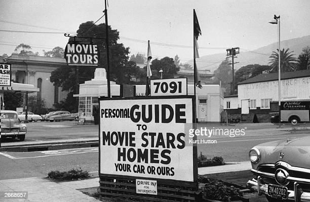 A sign advertising tours round the homes of Hollywood movie stars in Los Angeles California Original Publication Picture Post 5298 We Go To Hollywood...