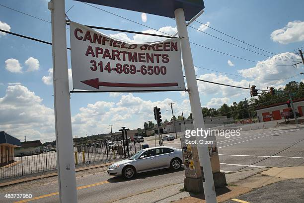 A sign advertising vacancies at Canfield Green apartments hangs above the intersection of West Florrisant Avenue and Canfield Street one year after...