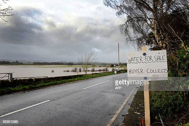 Sign advertising water for sale is pictured on a road near Dumfries, south-west Scotland, on November 22, 2009 after some 314 millimetres of rain...