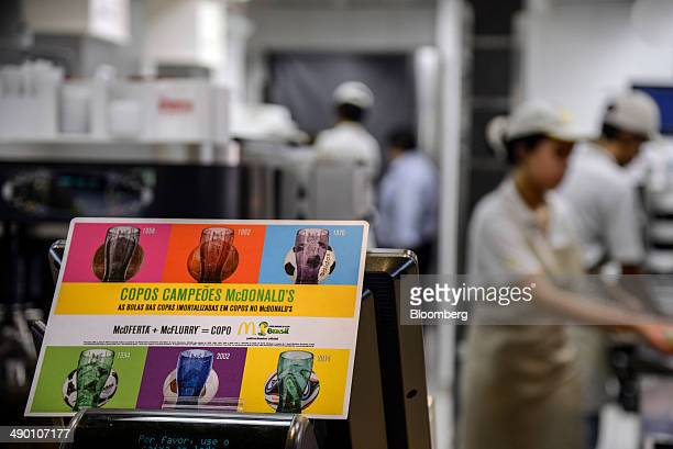 A sign advertising World Cup merchandise is displayed at a McDonald's Corp restaurant in Barueri Brazil on Tuesday April 29 2014 After being sued by...