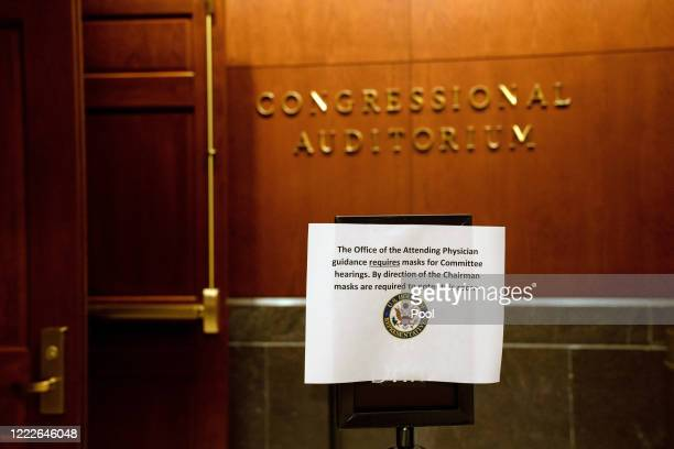A sign advises that masks are required to enter a hearing of the US House Judiciary Committee on at the Capitol Building June 24 2020 in Washington...