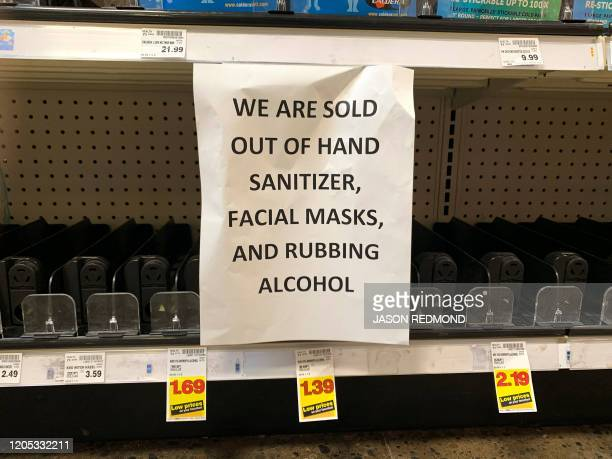 A sign advising outofstock sanitizer facial masks and rubbing alcohol is seen at a store following warnings about COVID19 in Kirkland Washington on...