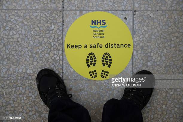 Sign advising visitors to social distance is pictured during a visit by Scotland's First Minister Nicola Sturgeon to the field hospital the NHS...
