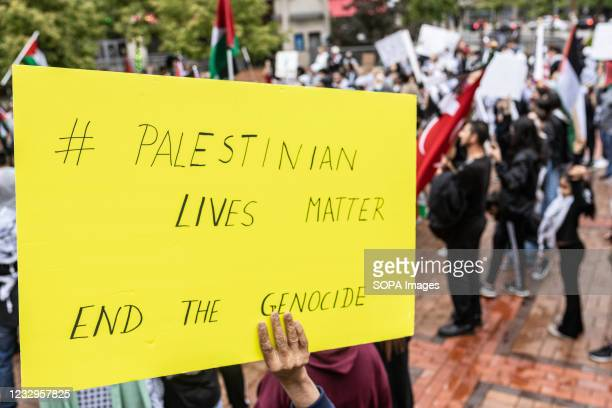 Sign advocates for an end to the killing of Palestinians by Israelis. Demonstrators met at Courthouse Square in Dayton, Ohio to rally and march...