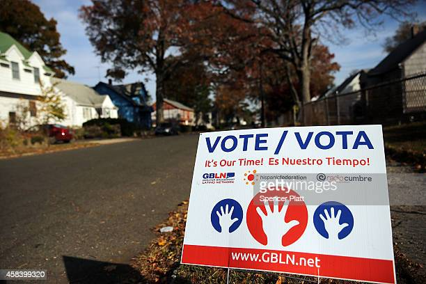 A sign advocating voting is seen outside of a polling station on November 4 2014 in Bridgeport Connecticut Around the country voters are turning out...