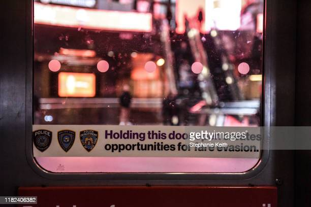 Sign against fare evasion is seen at a subway station on November 14, 2019 in New York City. The MTA, which oversees the New York City subway system,...