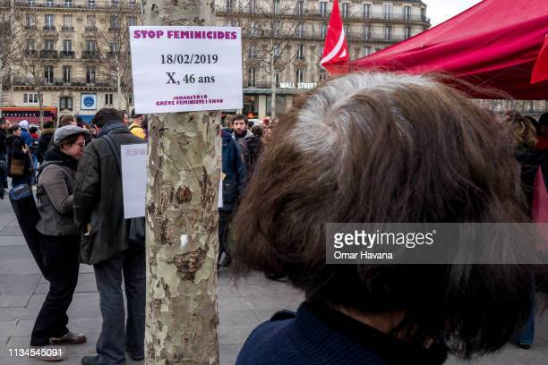 A sign against feminicide is seen hanging from a tree during the International Women's Rights Day on March 08 2019 in Paris France Several thousand...