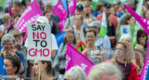 Sign agaisnt GMO Several thousand people demonstrated for a greener farming against industrial livestock farming a third runway for the Munich...