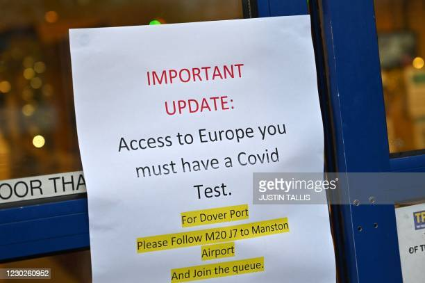 Sign alerting lorry drivers that they need to have a Covid-19 test before attempting to leave the UK for Europe, is pictured at the entrance to a...