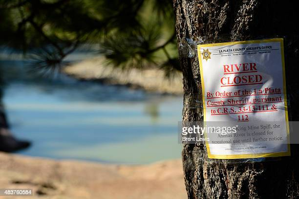 A sign alerting people of the Animas River's closure August 12 2015 at Baker's Bridge 'The river is returning to preevent conditions' said EPA...