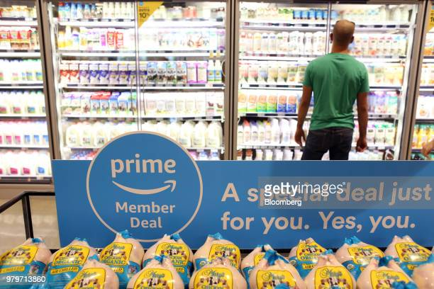 A sign alerts Amazoncom Inc Prime members of a special deal on organic chickens during the grand opening of a Whole Foods Market Inc location in...