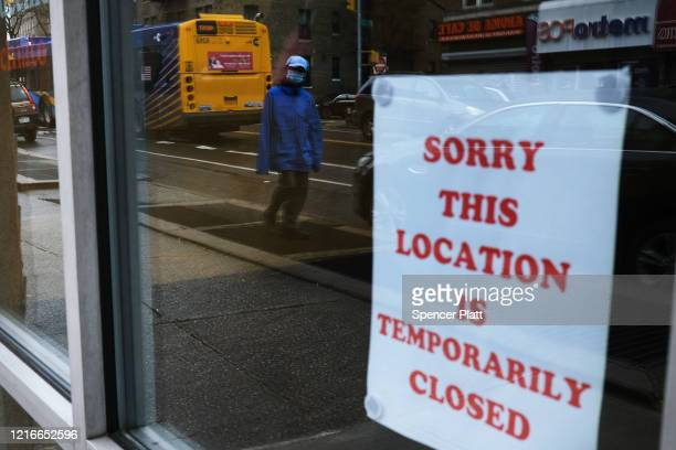 A sign alerts customers that a business in Queens which has one of the highest infection rates of coronavirus in the nation is closed on April 03...