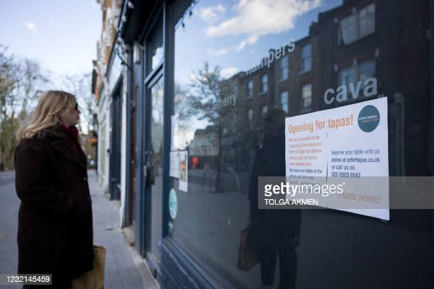 Sign alerts customers that a restaurant will re-open to outdoor diners on April 12, following the third Covid-19 lockdown, in Walthamstow, northeast...